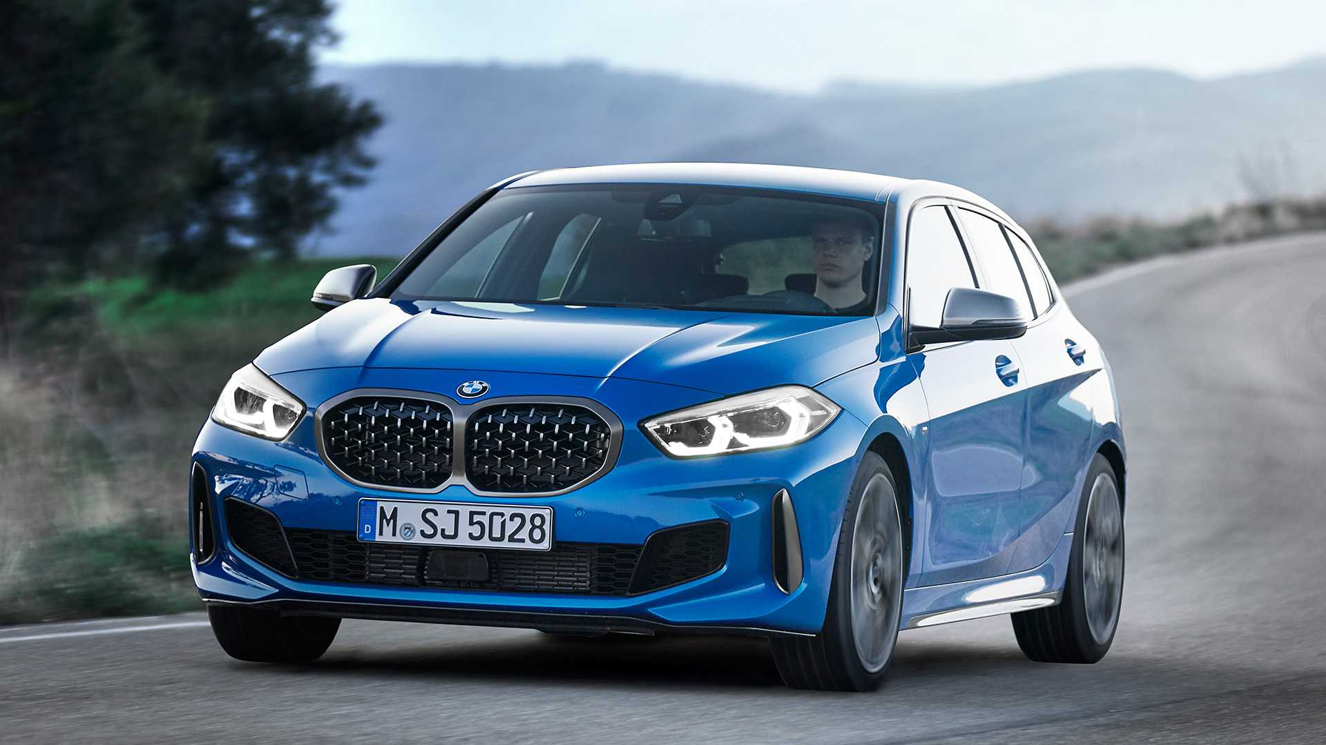2020 BMW M135i xDrive (Color: Misano Blue Metallic) Front Three-Quarter Wallpapers (3)