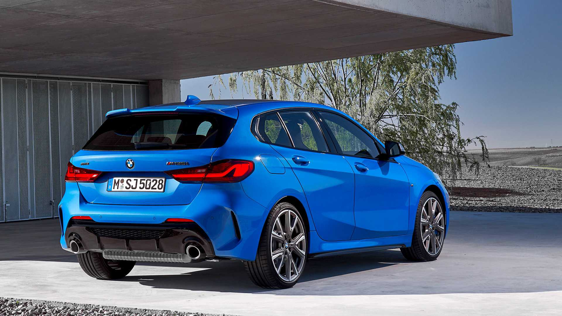 2020 BMW M135i xDrive (Color: Misano Blue Metallic) Rear Three-Quarter Wallpaper (12)