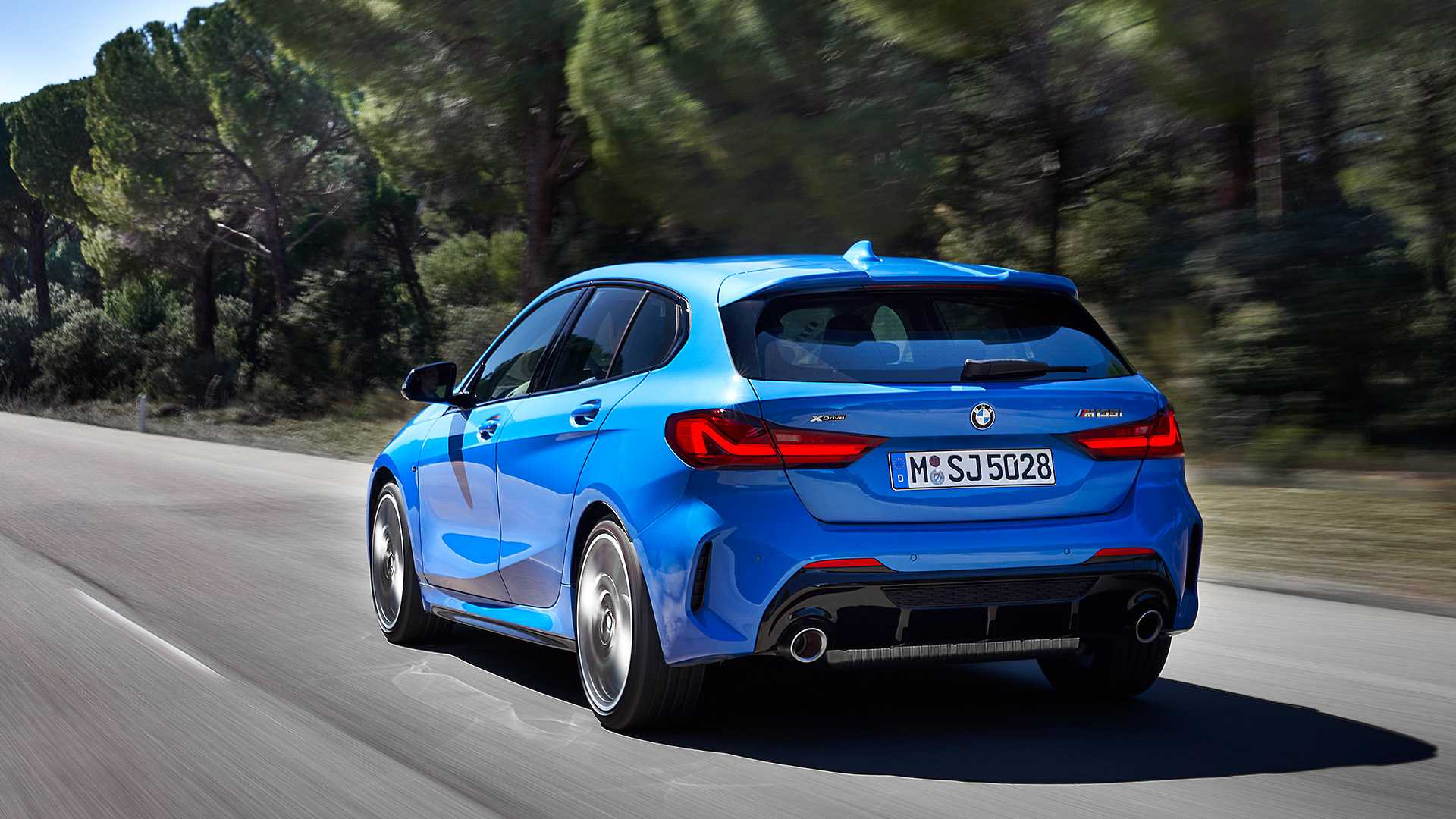 2020 BMW M135i xDrive (Color: Misano Blue Metallic) Rear Three-Quarter Wallpapers (7)