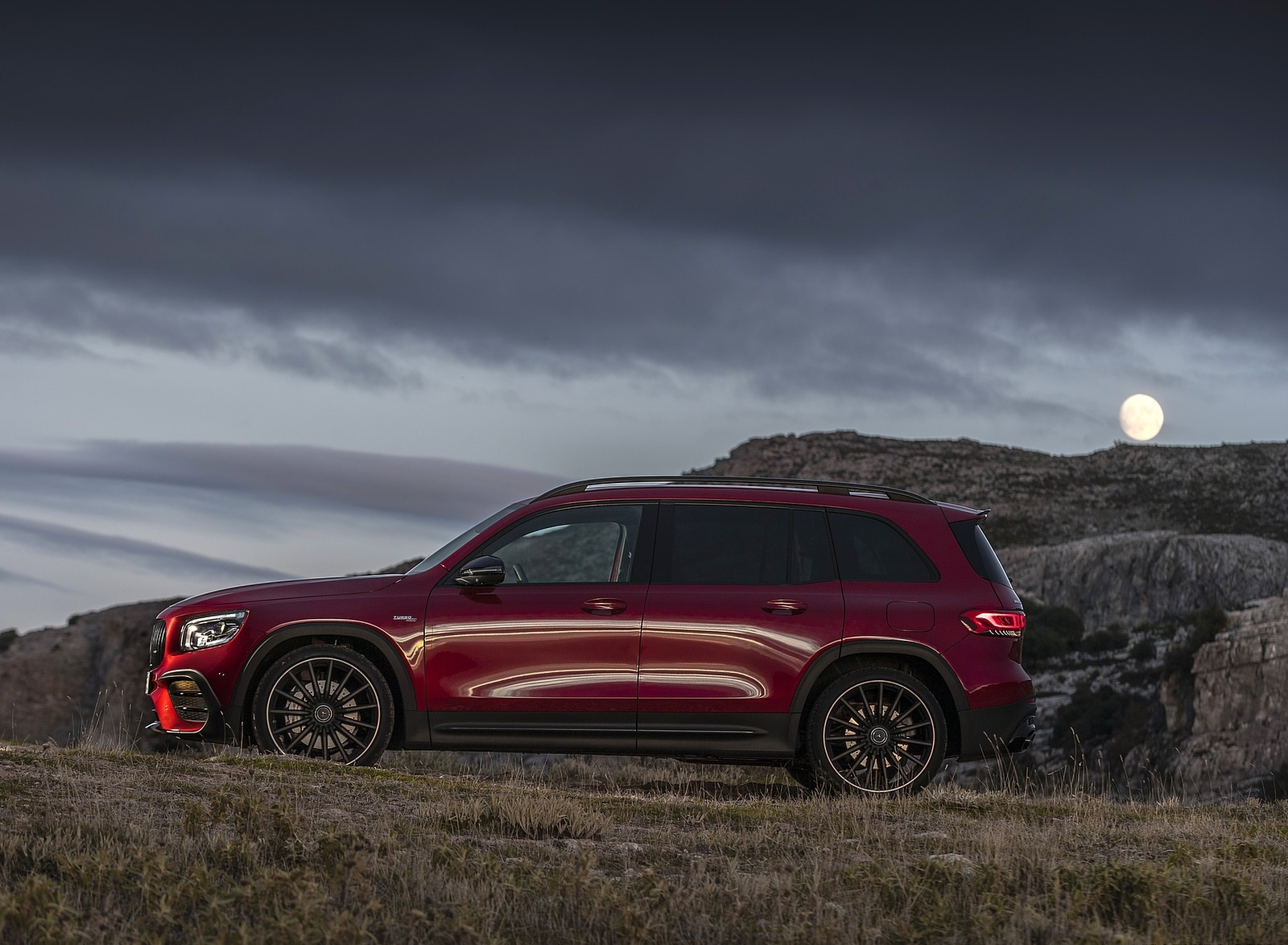2021 Mercedes-AMG GLB 35 4MATIC (Color: Designo Patagonia Red Metallic) Side Wallpapers (10)