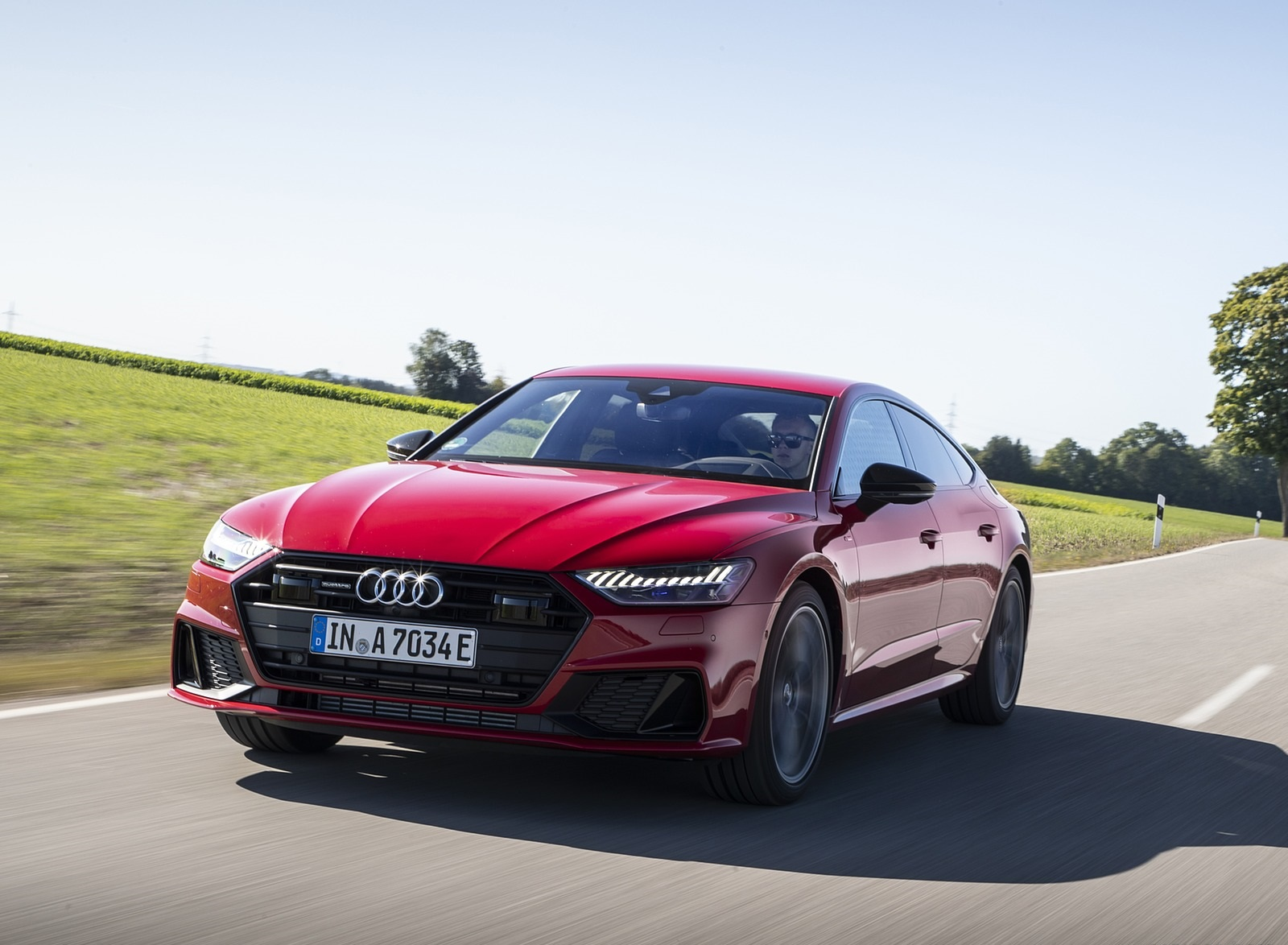 2020 Audi A7 Sportback 55 TFSI e quattro Plug-In Hybrid (Color: Tango Red) Front Three-Quarter Wallpapers (1)