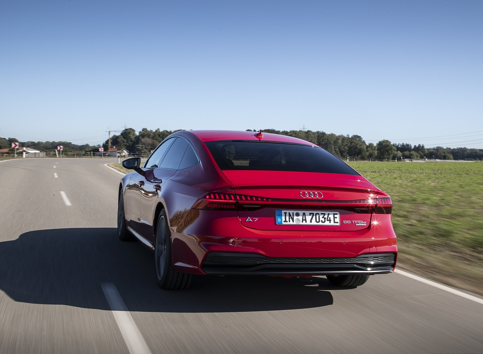 2020 Audi A7 Sportback 55 TFSI e quattro Plug-In Hybrid (Color: Tango Red) Rear Three-Quarter Wallpapers (6)